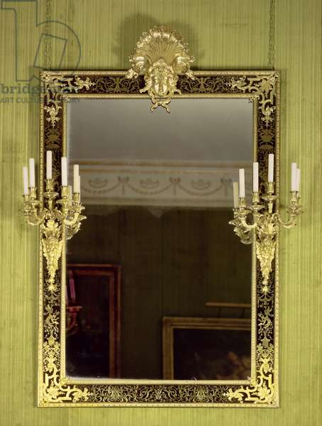 F51 Louis XIV wall mirror, with rectangular frame of Boulle marquetry, with flanking candelabrum, surmounted by an espagnolette head, attributed to Andre Charles Boulle (1642-1732)