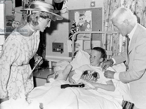 Princess Diana and Jimmy Saville talk to Scott Donaldson 11 years old of Corby at Stoke Manderville Hospital in the childrens ward. August 3rd 1983 *** Local Caption *** 01316006