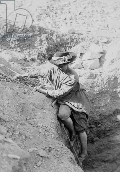 Hilda Petrie (née Urlin) descending by rope ladder into a tomb shaft, Possibly at Denderah, 1897-8 (b/w photo)
