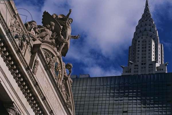 USA, New York City, Grand Central Terminal and the Chrysler Building set against blue sky