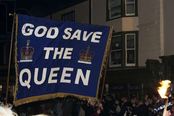 Great Britain, England, East Sussex, Lewes, revellers carrying banner 'God Save The Queen' on Bonfire Night (photo)