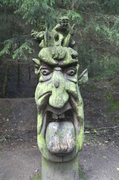 Lithuania, Curonian Spit, Juodkrante, Raganu Kalnas (Witches' Hill), wooden sculpture of a demon