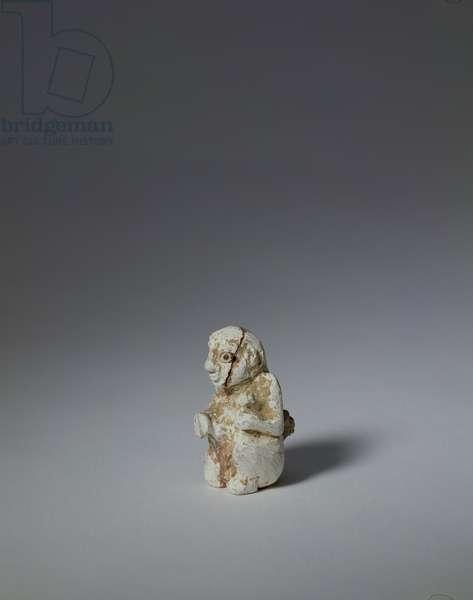 Kneeling woman, Uruk period (c.4000-3100 BC), c.3300-3000 BC (calcined limestone, shell & bitumen inlay)