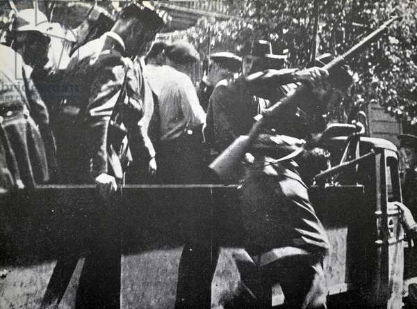 Nationalist Civil Guards arrive to take up positions in Madrid during the Spanish civil war 1937