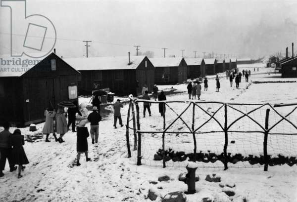 People leaving Buddhist church, Manzanar Reclocation Center, California, winter 1943 (photo)
