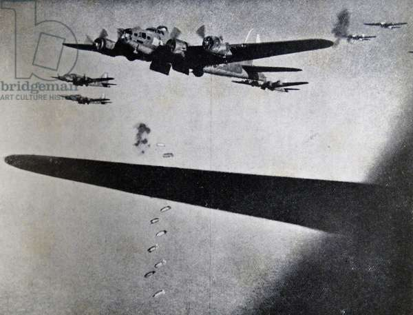 Photograph of Boeing B-17 Flying Fortresses dropping bombs