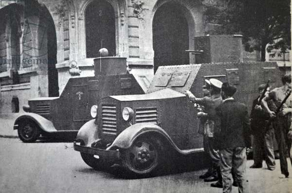 Two armoured cars protect Republican soldiers during street fighting in Barcelona, during the Spanish civil war 1936
