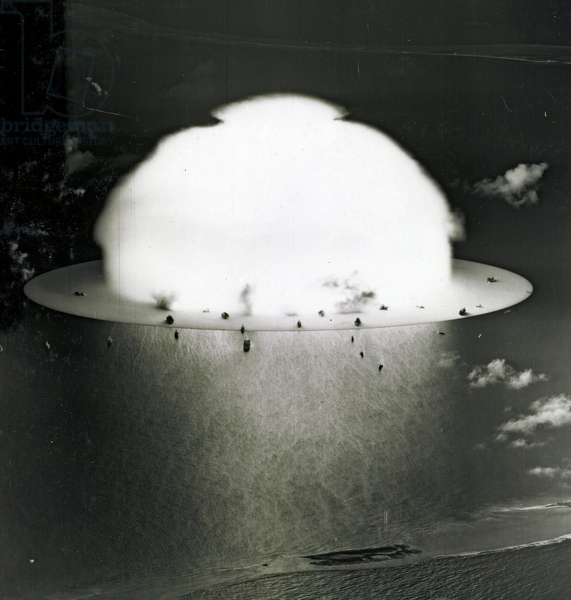 Mushroom cloud with ships below during Operation Crossroads nuclear weapons test, 1946