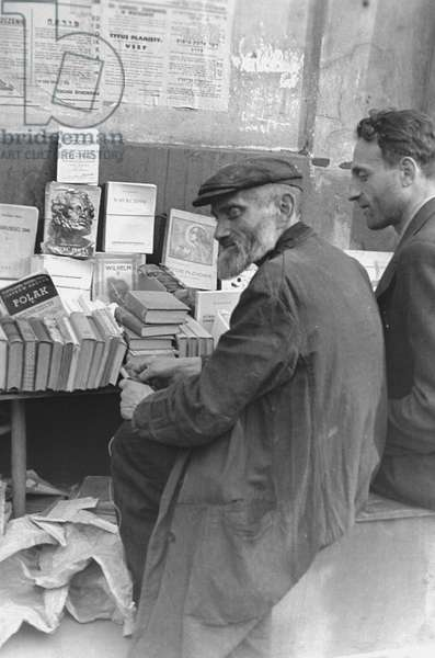 Jewish Bookseller in the Warsaw Ghetto (b/w photo)