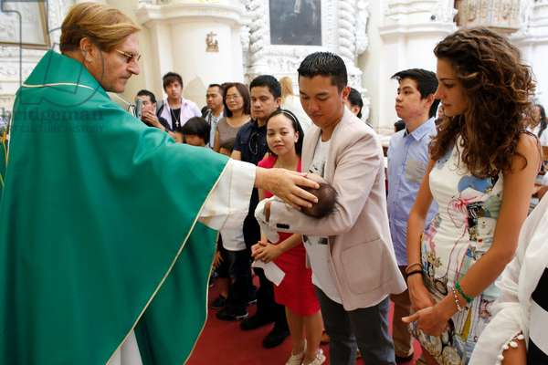 Baptism in a catholic church (photo)