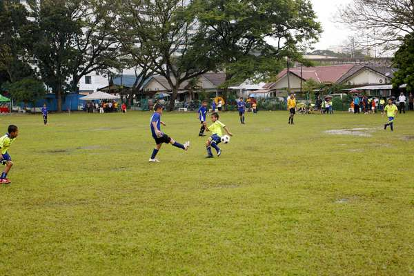 Young Boys playing Football (photo)