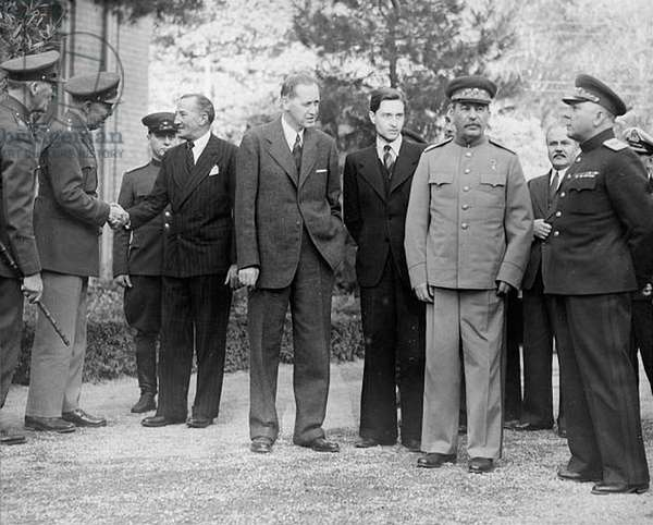 Tehran Conference, Iran, 28 Nov-1 Dec 1943.  Scene outside Russian Embassy with, centre, Roosevelt's adviser Harry Hopkis, Stalin's interpreter, Stalin, Molotov and General Voroshilov. Chief topic, opening of second front in Western Europe.