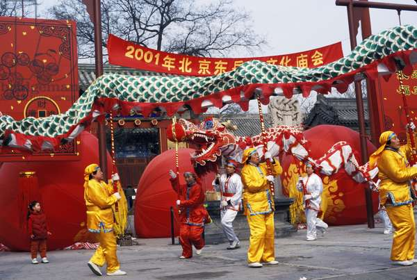 The Dragon Dance being performed at the New Year Temple Fair. Dongyuemiao. Beijing, China