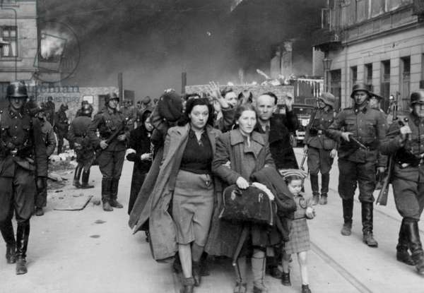 """Warsaw Ghetto Uprising – Photo from Jürgen Stroop Report to Heinrich Himmler from May 1943. The original German caption reads: """"Forcibly pulled out of dug-outs"""" (b/w photo)"""