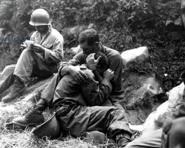 Korean War 1953. American soldier comforts another soldier in distress