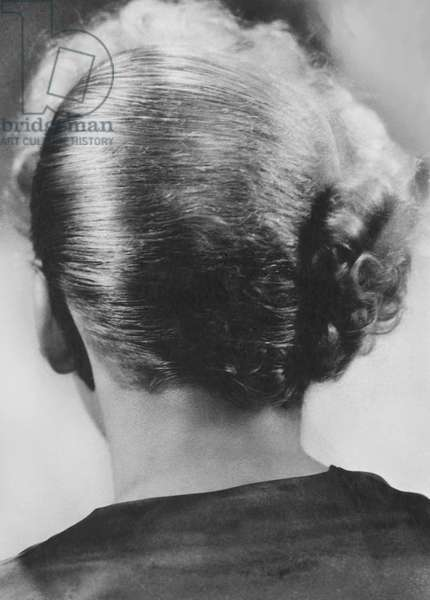 Hollywood, California: March 22, 1934 A photo of the back of actress and film director Ida Lupino's head showing her unusual hair style.  (b/w photo)