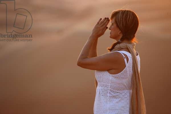 Sunset meditation in the desert (photo)