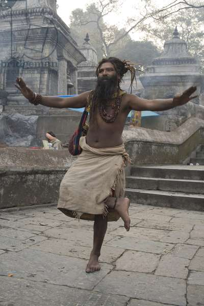 Holy man doing YOGA in the way to Pashupatinath Temple in 03 March 2008. In the Festival of ShivaRatri Lot of Holy men 'Sadhus' gather in Pashupatinath.  (photo)