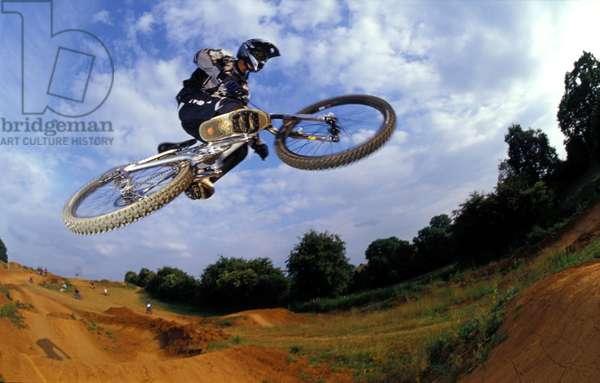 BMXer, Ian Gunner, getting some air, doing a jump,.