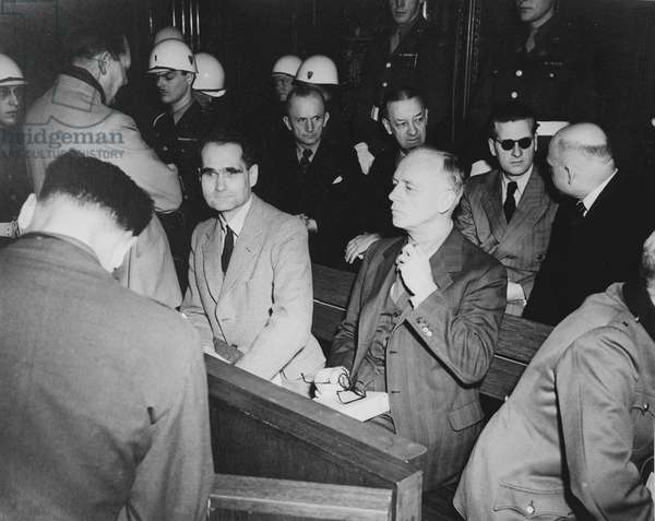 Rudolf Hess (1894-1987) prominent figure in Nazi Germany, acting as Adolf Hitler's deputy in the Nazi Party from 1926-41. Hess (centre in pale jacket) at the War Crimes Trials in Nuremberg, 1946.
