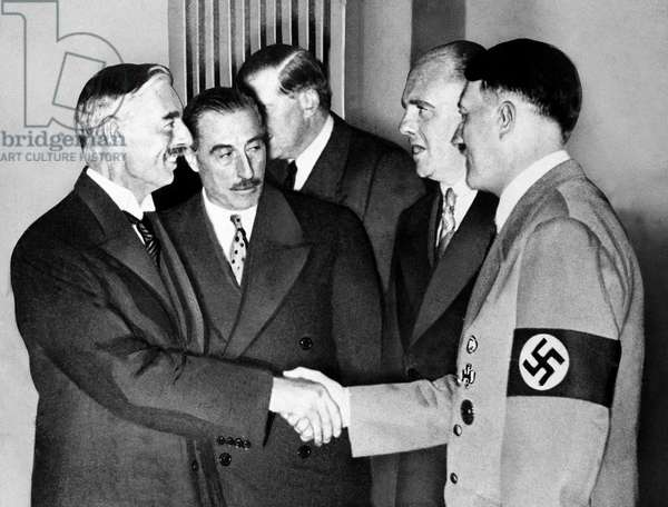 Adolf Hitler greets British  Prime Minister Neville chamberlain at Munich 1938