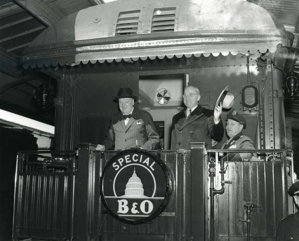 Prime Minister Winston Churchill, President Harry Truman and Gen Harry Vaughan at Union Station before embarking for the Truman home in Independence, Missouri. March 4, 1946 (b/w photo)
