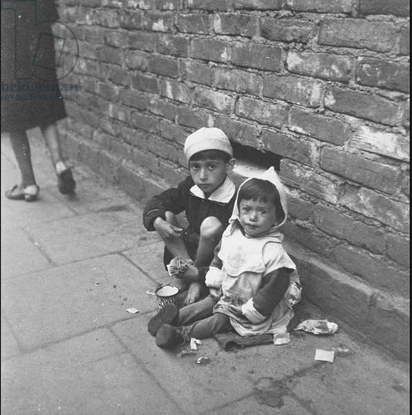 Jewish Children Beg for Food in the Warsaw Ghetto (b/w photo)