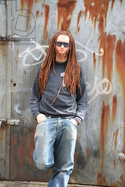 A man, with ginger dreadlocks, wearing sunglasses, London, UK, 2006.
