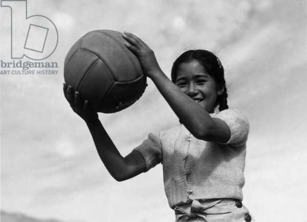 Girl and volley ball, Manzanar Relocation Center, California, 1943 (photo)