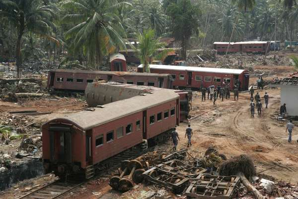 5th January 2005: View from the rooftop of the house of Karl Max Hantke and his wife Khanti Hantke, of the train that was swept away by the waves near Hikkadua. Karl and Khanti had climbed to the rooftop to safety. Sri Lanka Tsunami.  (photo)