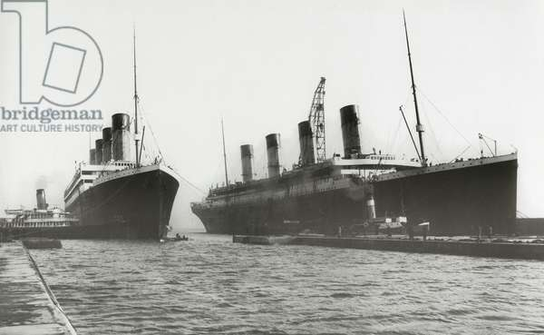 RMS Titanic being moved out of drydock to allow her sister ship, RMS Olympic, to have a propeller replaced, March 6, 1912 (b/w photo)