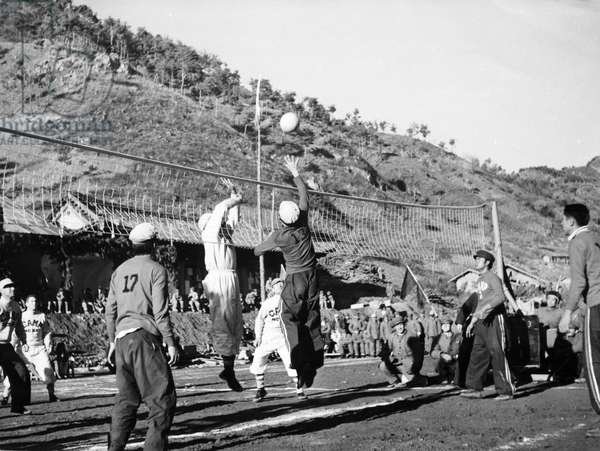 Korean War. A volleyball match between Camps 2 and 3 in the POW's Inter-camp Olympics sponsored by the Chinese People's Volunteers and the Korean People's Army. These games were held from November 15 through the 26th in 1952 somewhere in Korea.