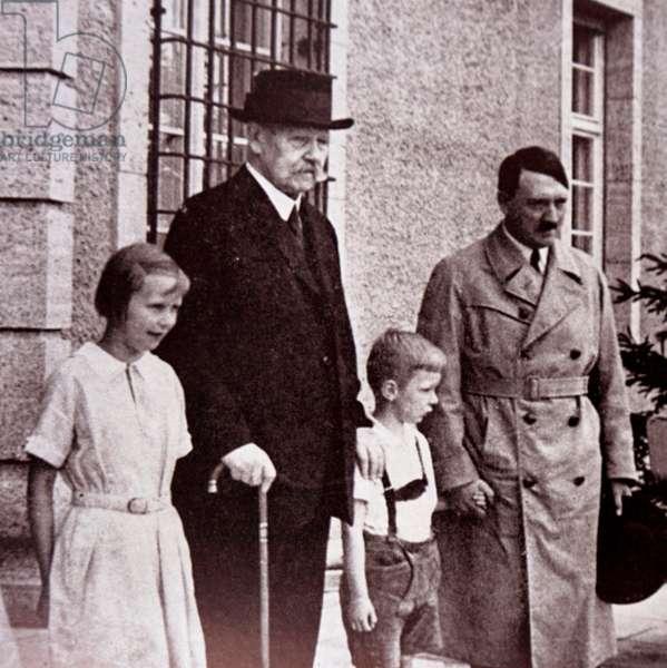 Paul von Hindenburg and Adolf Hitler.