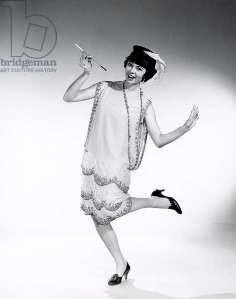Portrait of woman dressed as flapper (b/w photo)