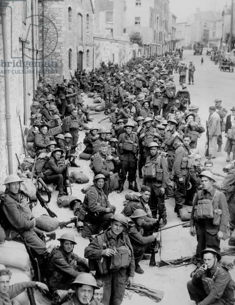 British Soldiers Waiting Around in the Streets, hoping to be evacuated back to Britain, May 1940 (b/w photo)