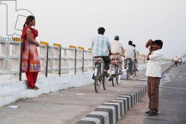 Man Photographing His Wife on the Mahatma Gandhi Seti (Bridge), Patna, Bihar, India (photo)