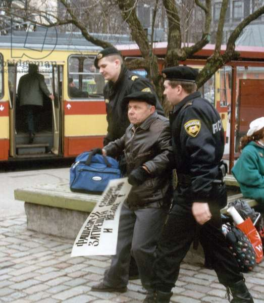 Riga, Latvia, April 10 2001: Russian Citizen, Resident of Latvia, Anatoly Nautsevich, Was Arrested as He Took Part in Unapproved Demonstration in Support of Three Other Russian Citizens, Accused of Terrorism for their Protest Action at the Observation Platform of the Tower of St. Peter'S Church in Downtown Riga, in November 2000, Against Latvian Intentions to Join Nato.
