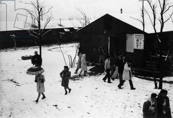 People leaving Buddhist church, winter II, Manzanar Relocation Center, California, 1943 (photo)