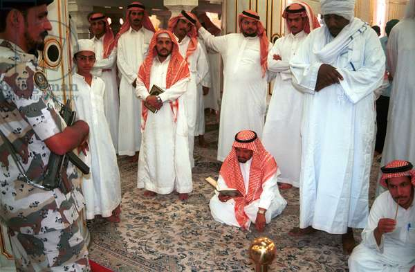 The Arabs people at the prophet Mohammad great mosque in Al-Madina city. The grave of Prophet Mohammad is in this mosque and Al-Madina is one of two major and holy cities in the world for muslims which placed in the Kingdom of Saudi Arabia, the other sacred city is Mecca.  (photo)