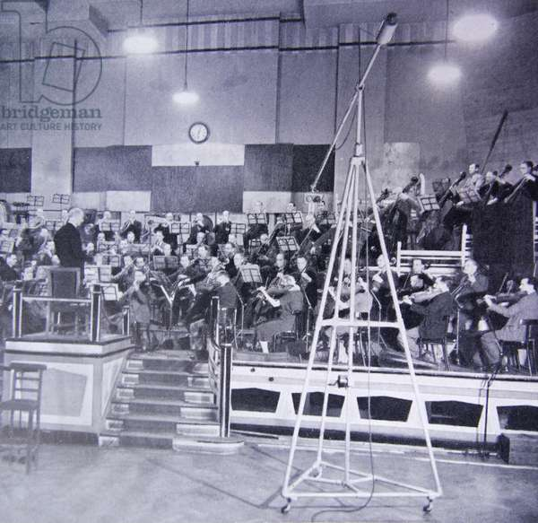 Photograph of Sir Adrian Cedric Boult conducting the BBC Symphony Orchestra