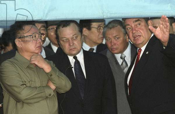 North Korean Leader Kim Jong-Il (L) Listens to Explanations of the President of the Jsc 'Vladivostok Commercial Seaport' Mikhail Robkanov (R), at the Port on Friday, 8/23/02, a Special Awning Was Erected Here to Protect the Honourable Guest from the Heavy Rain, Second Right is Vladivostok Mayor Yuri Kopylov.