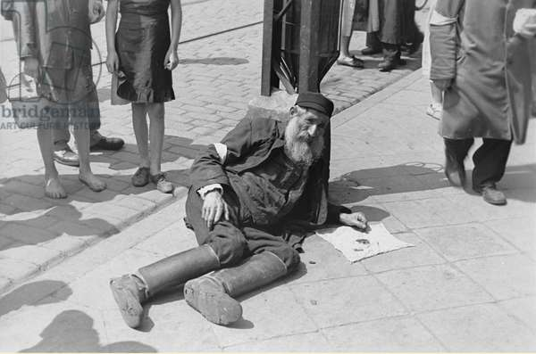 Collapsed on a Warsaw Ghetto Street (b/w photo)