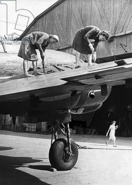 Two Women Working on the Metal Covering of a Wing of a Soviet Military Plane During World War 2, September 1944.