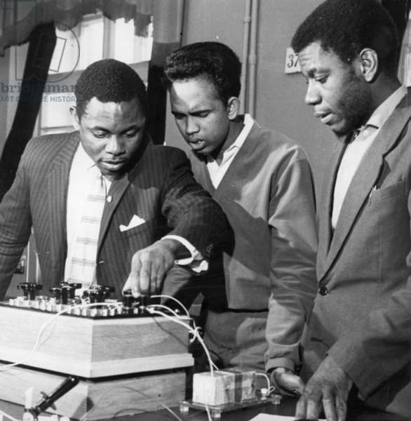 The Peoples' Friendship University in Moscow, Founded in 1960 and Renamed the Patrice Lumumba University in 1961, Second Year Engineering Students (L to R) Erick Omeili (Nigeria), Danasena Suria Arachige (Ceylon), and Abdulla Hadji (Zanzibar) During Studies in the Electric Laboratory, Early 1960s.