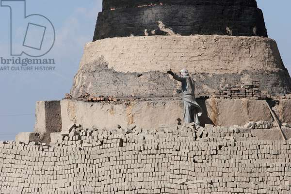 Man Working on A Brick Kiln in the Outskirts of Kabul, Afghanistan (photo)