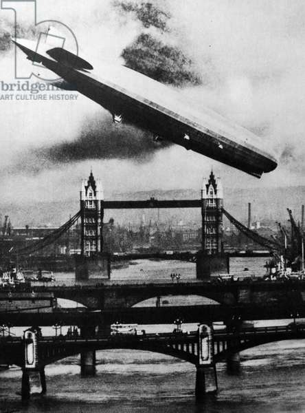 The German airship the Graff Zeppelin flies over Tower Bridge, London, 1931
