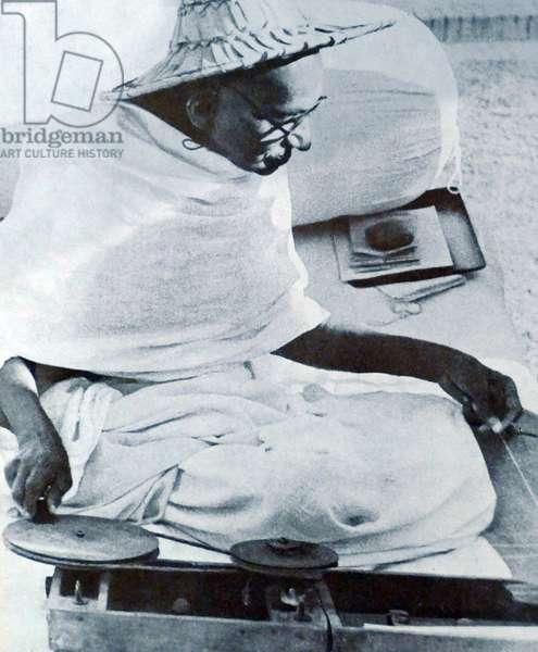 Mohandas Karamchand Gandhi spinning cloth in 1940