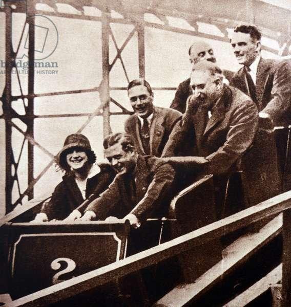 Edward VIII (as Prince of Wales) enjoys a fairground ride, 1933