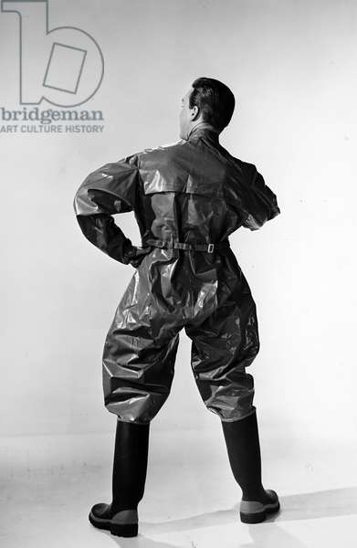 Terylene' a heavy suit worn by workers handling products at an oil refinery, 1950