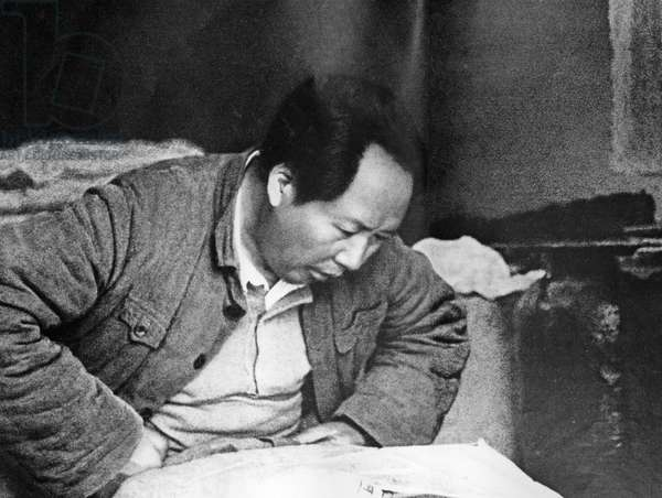 Chairman Mao Working in a Peasant Cottage at Wangchiawan, Northern Shensi, During the Time of the Civil War Against the Chiang Kai-Shek Regime.